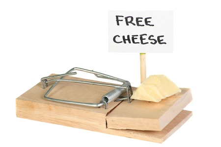 booby trap: Mousetrap with free cheese sign entrapment concept Stock Photo