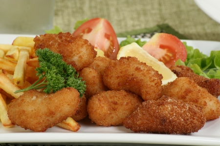 deep fried breaded scampi with fries lettuce and tomato