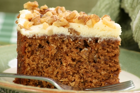 carrot cake: slice of home made carrot cake with buttercream icing