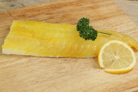 haddock: portion of uncooked smoked haddock with parsley and lemon