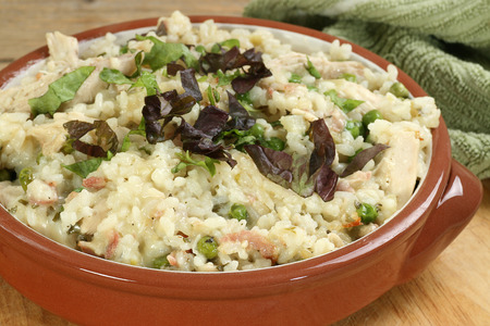 food chicken and bacon risotto in a terracotta bowl