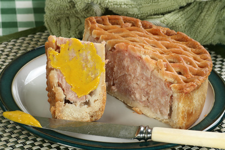 lattice top pork pie with hot english mustard                            photo