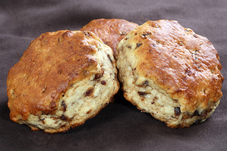 maple syrup: closeup of three date and maple syrup scones