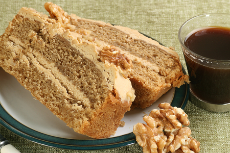 walnut cake: ttwo slices of coffee and walnut cake wit cup of coffee