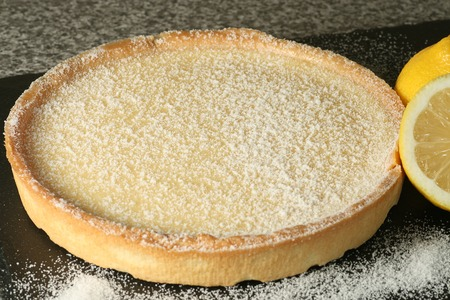 tarte au citron lemon tart with sugar dusting