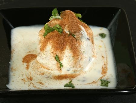 chaat: lentil dumpling in savoury yoghurt sauce with cinnamon and coriander