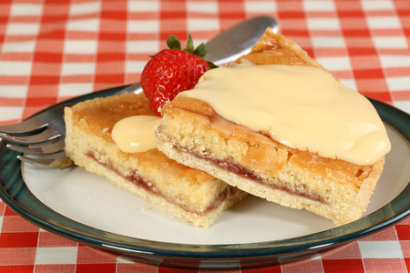 custard slices: two slices of fresh bakewell pudding with a custard topping
