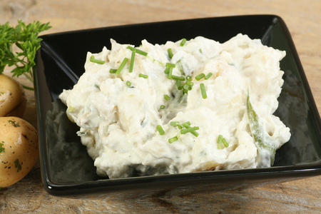salad bowl: bowl of potato salad with chives and parsley