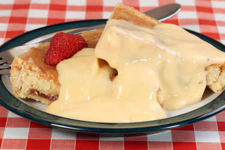 custard slice: slice of bakewell pudding with strawberries and custard