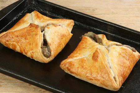 stilton: stilton and mushroom en croute on a baking tray