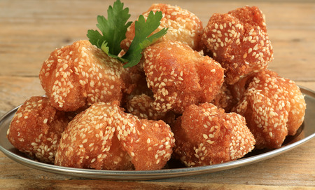 indian sweet: marasay indian sweet fried rice balls dipped in sesame seeds