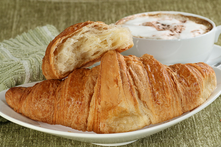 delicious fresh all butter croissant with coffee Standard-Bild - 105356746