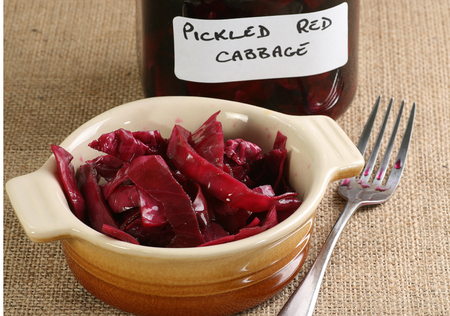 home made pickled red cabbage in a rustic earthenware dish