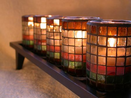 five candles in stained glass holders Stock Photo