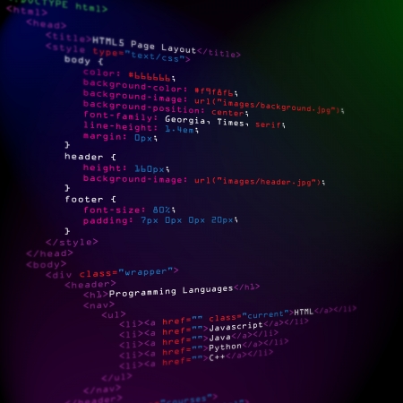 html 5: Color coded HTML and CSS programming languages on screen Stock Photo
