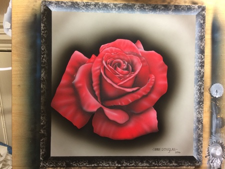 metal: A Rose airbrushed on a 12x12 metal panel. Painted by Jamie Douglas.