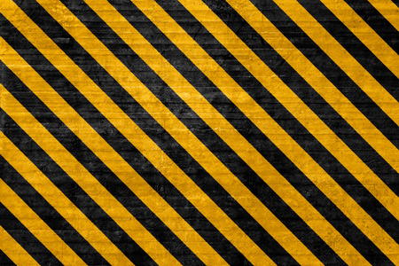 hazard stripes: Textured hazard background with Black and yellow angled lines