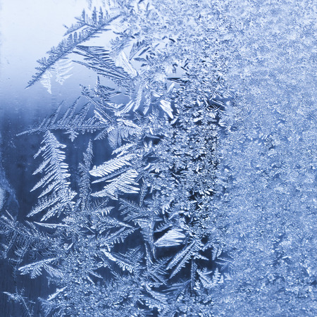 Frosty winter background photo of ice buildup on a window