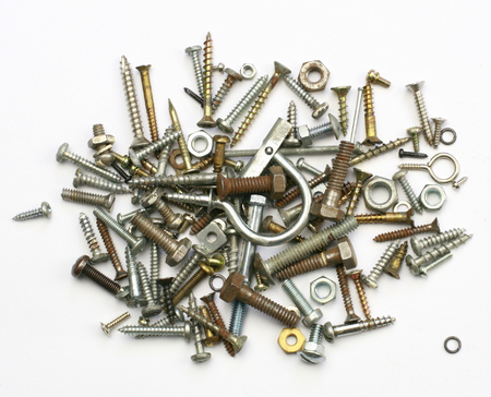 A pile of nuts,bolts, screws and other fasteners on a white background