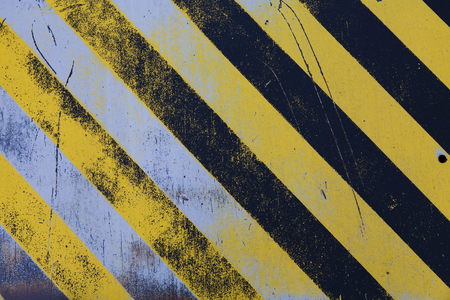 black textured background: Textured hazard background with Black and yellow angled lines