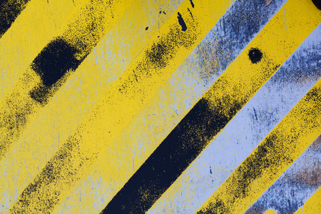 angled: Textured hazard background with Black and yellow angled lines