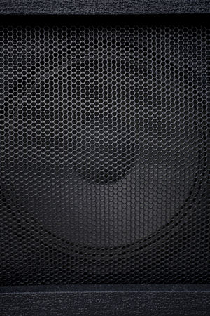 abstract music: Black textured speaker grille background