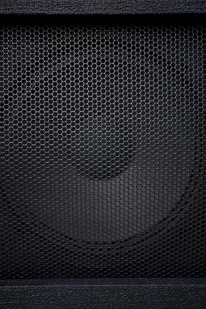 grille: Black textured speaker grille background