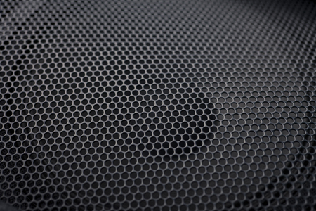 grille: Black textured speaker grille background