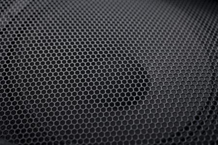 grille': Black textured speaker grille background