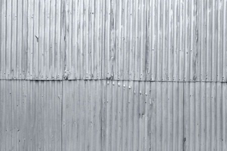 corrugated steel: Rough grunge textured old corrugated steel background Stock Photo