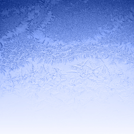 wintry weather: Frosty winter background photo of ice buildup on a window