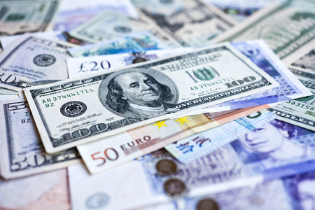 International currencies. Money from the United States, Europe and Hong Kong