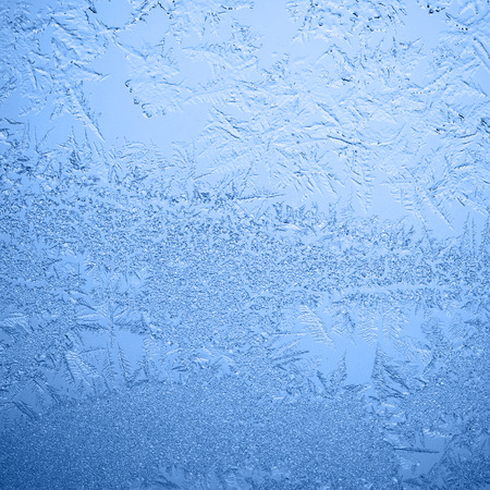crystallization: Frosty winter background photo of ice buildup on a window