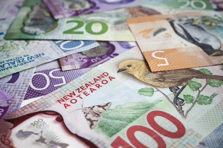 Pile of New Zealand currency laying flat on table Stock Photo