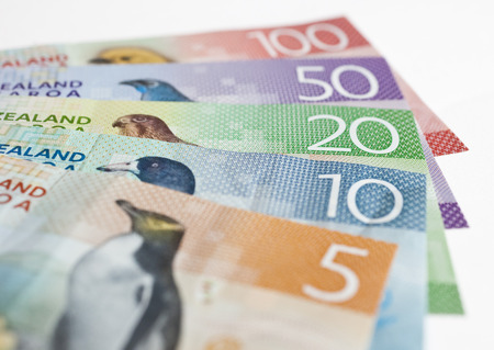 fifty dollar bill: Pile of New Zealand currency laying flat on table Stock Photo