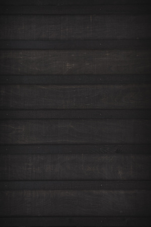 black board and batten textured wall background Imagens