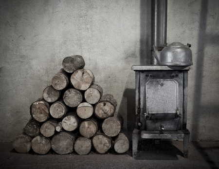 woodburner: Firewood next to an old woodburner