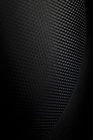 Black textured abstract dark grille pattern background