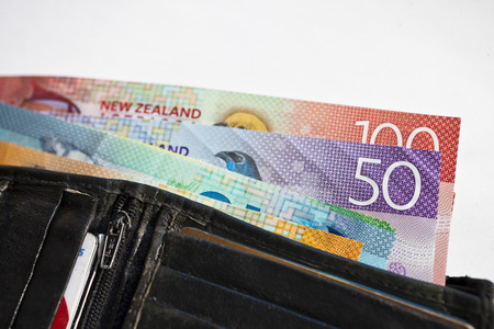 New Zealand cash, money or currency fanned out in someones wallet Stock Photo