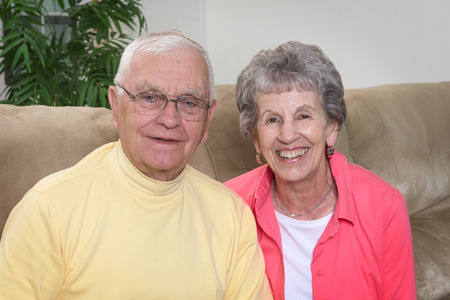 Smiling couple in their mid-eighties.