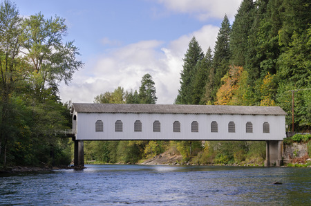 View of the historic Goodpasture covered bridge outside of Eugene, Oregon, as viewed while floating down the river. 写真素材