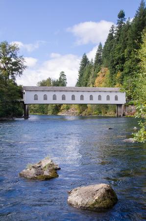 eugene: The historic Goodpasture covered bridge outside of Eugene, Oregon, under brilliant blue early fall sky.