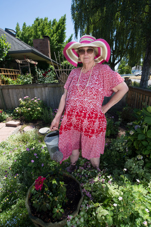 inappropriate: Humorous image of a gardening granny in her garden.