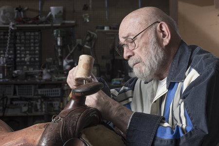 Profile of a saddle maker working at his craft.