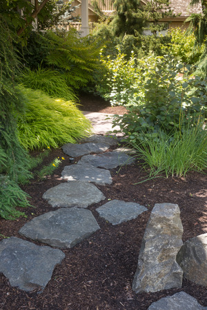 flagstone: A flagstone pathway through landscape design. Stock Photo
