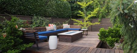 Panorama of a contemporary outdoor conversation inspired by oriental design. Archivio Fotografico
