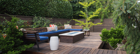 wooden furniture: Panorama of a contemporary outdoor conversation inspired by oriental design. Stock Photo