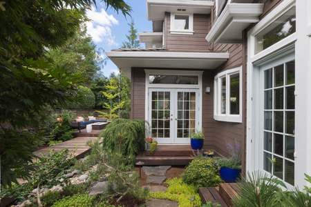 A narrow deck goes past double doors in the backyard of this contemporary home.