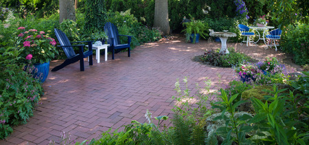 retreat: Panorama of a secluded patio retreat ready for close friends, relaxation, and conversation. Stock Photo