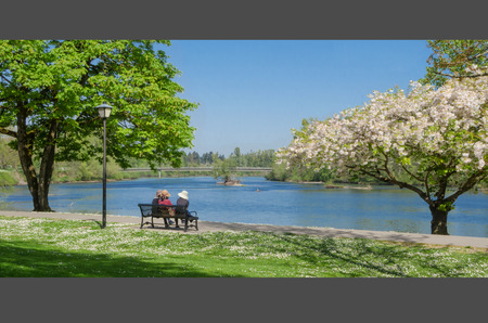 Watching the Willamette River from the Eugene bike path. 写真素材